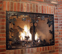 Deschutes Brewery fireplace door with hand forged hop vines and tap handles