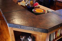 copper kitchen island with ahnd forged iron banding