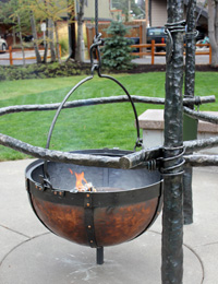 copper cauldron fire pit with burning fire