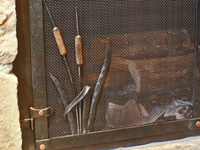 wrought iron cat tail detail for fireplace doors