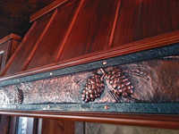 pine cone reppousse range hood strap