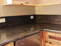 zinc countertop with hammered zinc backsplash