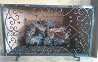 Hand forged fireplace screens by blacksmiths at Ponderosa Forge