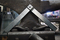 Hand forged fireplace door handle option by blacksmiths at Ponderosa Forge